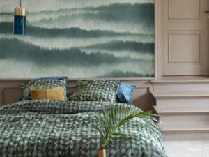 bed opgedekt met groen dekbedovertrek met touwen van at home