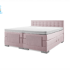 elektrische boxspring in de kleur roze met knopen hoofdbord