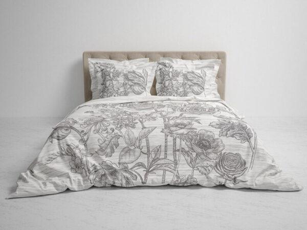 bed opgedekt met een lichtgrijs grey Dekbedovertrek Dimont lining waar een donkergrijze bloementekening op staat van Heckett Lane